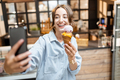 Cheerful woman with ice cream in the shop - PhotoDune Item for Sale