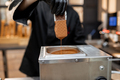Chef dips ice cream into the hot melted chocolate - PhotoDune Item for Sale
