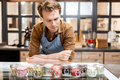 Confectioner trying different food additives for ice cream - PhotoDune Item for Sale