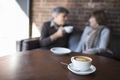 Two people sitting in a coffee shop having coffee - PhotoDune Item for Sale