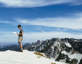 A hiker on the mountain summit,looking at a map in a wilderness area - PhotoDune Item for Sale