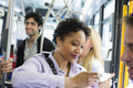 People, men and women on a city bus,woman on her phone - PhotoDune Item for Sale