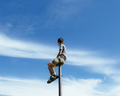 Man sitting and balancing on top of a metal post,Mount Baker-Snoqualmie national forest - PhotoDune Item for Sale