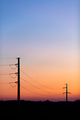 High voltage power tower over sunset clear sky, blackout concept - PhotoDune Item for Sale