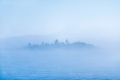 Pond or lake with fog and blurred island. - PhotoDune Item for Sale