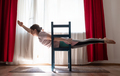 Young woman practicing yoga in Superman Pose or Viparita Shalabhasana using chair - PhotoDune Item for Sale