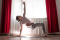Caucasian woman doing Vasisthasana variation or Side Plank yoga pose - PhotoDune Item for Sale