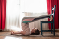 Sporty yoga girl doing yoag pose halasana at home - PhotoDune Item for Sale