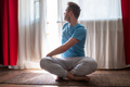 Portrait of healthy young man doing yoga Spine twisting pose - PhotoDune Item for Sale