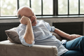 Senior hispanic confined man taking a nap in sofa at home - PhotoDune Item for Sale