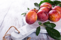 Fresh plums on marble cutting board - PhotoDune Item for Sale