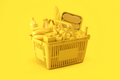 Yellow shopping basket with yellow food on yellow background. Food delivery. - PhotoDune Item for Sale
