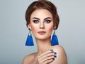 Beautiful Woman with Large Earrings Tassels - PhotoDune Item for Sale