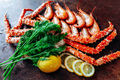 On the table are shrimp, crab, lemon and herbs. Table of reddish color. - PhotoDune Item for Sale