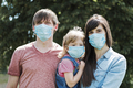 Young family with daughter wearing face masks - PhotoDune Item for Sale