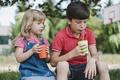 Two young children enjoying a healthy drink - PhotoDune Item for Sale