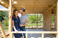 Couple standing on future window in construction site of their new house, dreams come true - PhotoDune Item for Sale