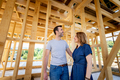 Couple make their dreams of building their own home come true visiting house under construction - PhotoDune Item for Sale