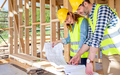 Construction engineer and architect consult plans on building site - PhotoDune Item for Sale