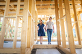 Loving couple at construction site of their new home dreams come true - PhotoDune Item for Sale