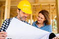 Female investor meeting with architect or engineer on construction site - PhotoDune Item for Sale