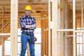 Builder worker on construction site of frame house - PhotoDune Item for Sale