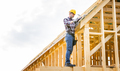 Roofer builder working on roof structure at construction site - PhotoDune Item for Sale