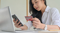 Young women are using smartphone and credit card with laptop. - PhotoDune Item for Sale