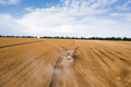 Aerial top view of combine harvester working on wheat field - PhotoDune Item for Sale