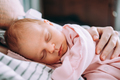 Cute newborn baby sleeping with mother. Happy Family concept. - PhotoDune Item for Sale