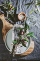 Top view of table setting with gray Linen tablecloth and napkin, white plate, cutlery and and olive - PhotoDune Item for Sale