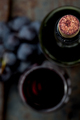 Top view of red wine bottle. Macro selective focus on wine cork. Wine bottle, wine glass and grape - PhotoDune Item for Sale