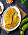 COLOMBIAN CARIBBEAN CENTRAL AMERICAN FOOD. Patacon or toston, fried and flattened whole green - PhotoDune Item for Sale