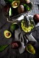 Avocado. Guacamole. Mexican guacamole sauce in stone mortar, full basket with avocado, half of - PhotoDune Item for Sale