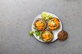 Fresh opened sea urchins. Caviar of sea urchins with onion, cilantro and lemon inside of shell of - PhotoDune Item for Sale