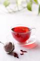 Healthy hibiscus tea in transparent cup - PhotoDune Item for Sale