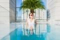 Portrait beautiful young asian woman relax leisure around swimming pool - PhotoDune Item for Sale