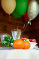 Table full of vegeterian food with air balloons on wooden background - PhotoDune Item for Sale