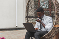 Business african american man holding smartphone, dictating voice message - PhotoDune Item for Sale