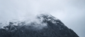 Snowy mountain on a misty day - PhotoDune Item for Sale