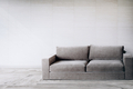Gray couch against a wall mockup - PhotoDune Item for Sale