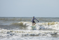 Middle aged man surfs on a longboard in the Atlantic. - PhotoDune Item for Sale