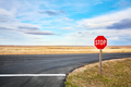 Stop road sign at an intersection. - PhotoDune Item for Sale