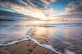 Sunrise view at a sandy beach with waves - PhotoDune Item for Sale