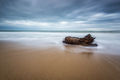 Stormy morning view at a sandy beach with waves - PhotoDune Item for Sale