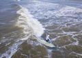 Aerial view of man surfing a long board on the Atlantic Ocean. - PhotoDune Item for Sale