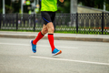 male runner in bright red compression socks - PhotoDune Item for Sale