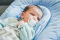 Newborn girl using a pacifier - PhotoDune Item for Sale