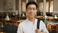 Portrait of smiling asian student with backpack happily looking in camera in library - PhotoDune Item for Sale
