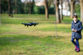 Nine-year-old girl operating toy drone flying by remote control - PhotoDune Item for Sale